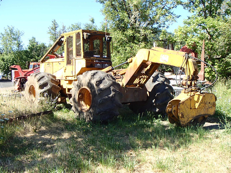 Tired looking grapple skidder at  Weist Logging Philomath, OR