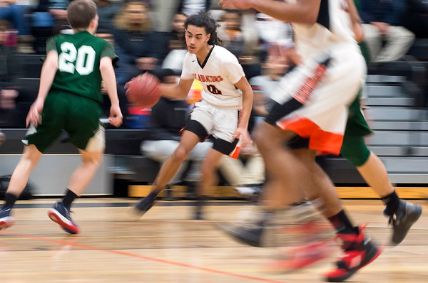 02/07/20 Wesley Bunnell | StaffrrGoodwin Tech boys basketball defeated Cheney Tech at home on Friday February 7, 2020. Damien Garcia (10) breaks towards the basket.