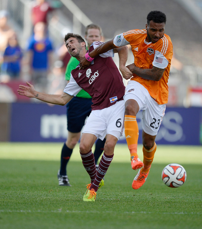 . Houston Dynamo midfielder Giles Barnes (23) gives a shove to Colorado Rapids midfielder Jose Mari (6) as he goes after the ball during the first half June 1, 2014 at Dick\'s Sporting Goods Park. (Photo by John Leyba/The Denver Post)