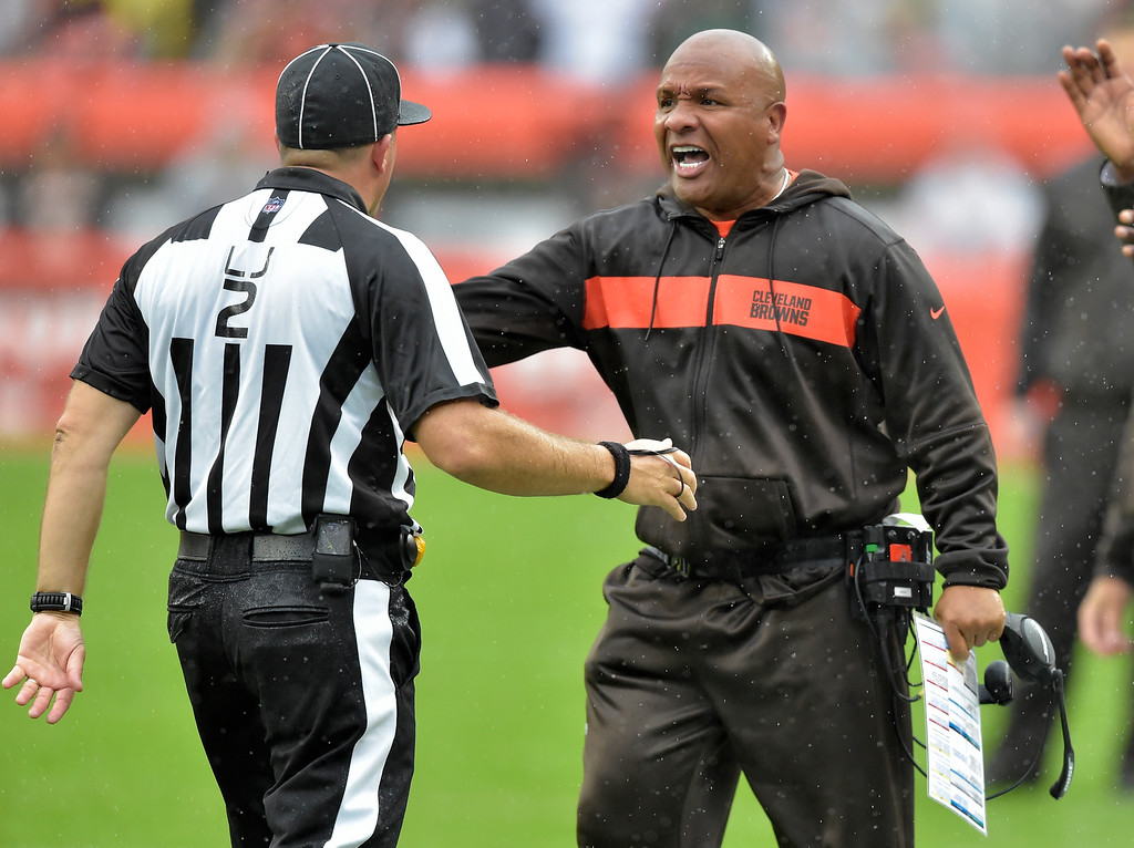 . Cleveland Browns head coach Hue Jackson shows his frustration to line judge Bart Longson during the first half of an NFL football game against the Pittsburgh Steelers, Sunday, Sept. 9, 2018, in Cleveland. (AP Photo/David Richard)