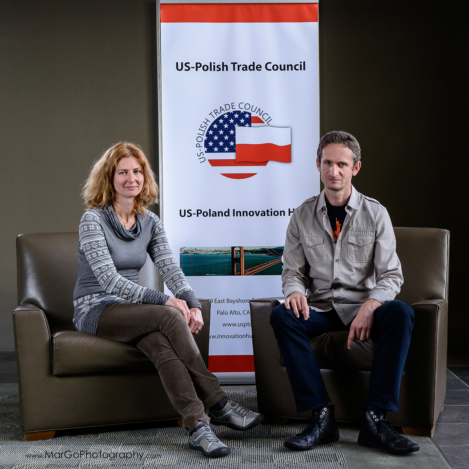 business portrait of the man and woman sitting on the chairs