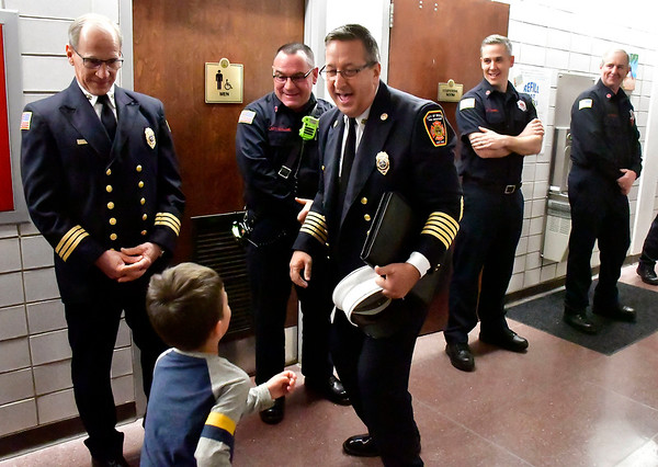 1/14/2020 Mike Orazzi | Staff rRetiring Bristol Fire Chief Jay Kolakoski is greeted by his grandson Adrian Silva,3, while honored at Bristol City Hall on his way to his last fire board meeting on Tuesday evening.