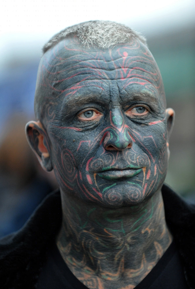 Description of . Picture taken on November 5, 2012 shows Czech fully-tattooed artist and drama professor Vladimir Franz as he announces the collection of 88,388 signatures to become eligible for the Czech presidential elections 2013, in Prague, Czech Republic. Despite having no political track record, Franz is running third among nine contenders, according to some opinion polls.