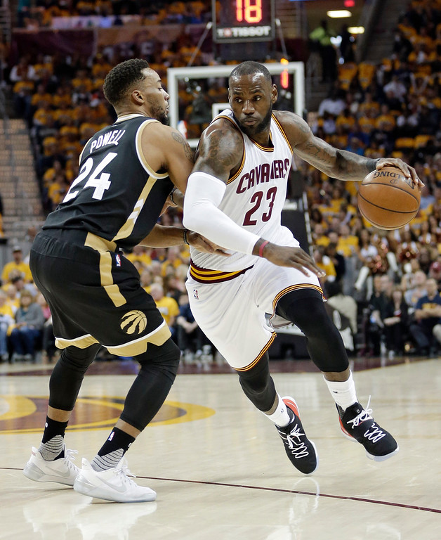 . Cleveland Cavaliers\' LeBron James (23) drives against Toronto Raptors\' Norman Powell (24) during the first half in Game 2 of a second-round NBA basketball playoff series, Wednesday, May 3, 2017, in Cleveland. (AP Photo/Tony Dejak)