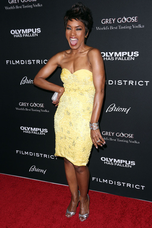 """. Actress Angela Bassett attends the Premiere of FilmDistrict\'s \""""Olympus Has Fallen\"""" at the ArcLight Cinemas Cinerama Dome on March 18, 2013 in Hollywood, California.  (Photo by Frederick M. Brown/Getty Images)"""