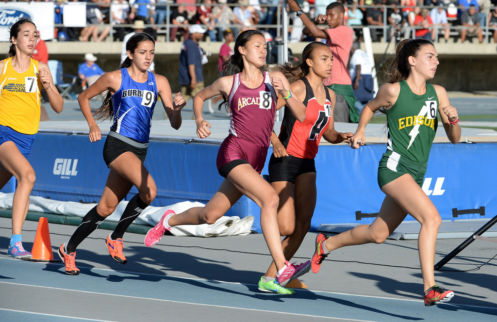 . Arcadia\'s Veronica Yamane (8) competes in the 1600 meter run during the CIF-SS Masters Track and Field meet at Falcon Field on the campus of Cerritos College in Norwalk, Calif., on Friday, May 30, 2014.   (Keith Birmingham/Pasadena Star-News)