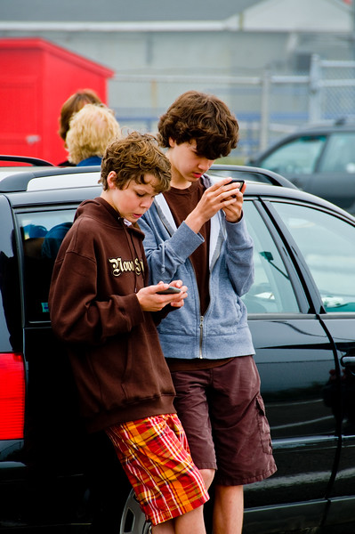 These boys seemed quite content to play with their gameboys.