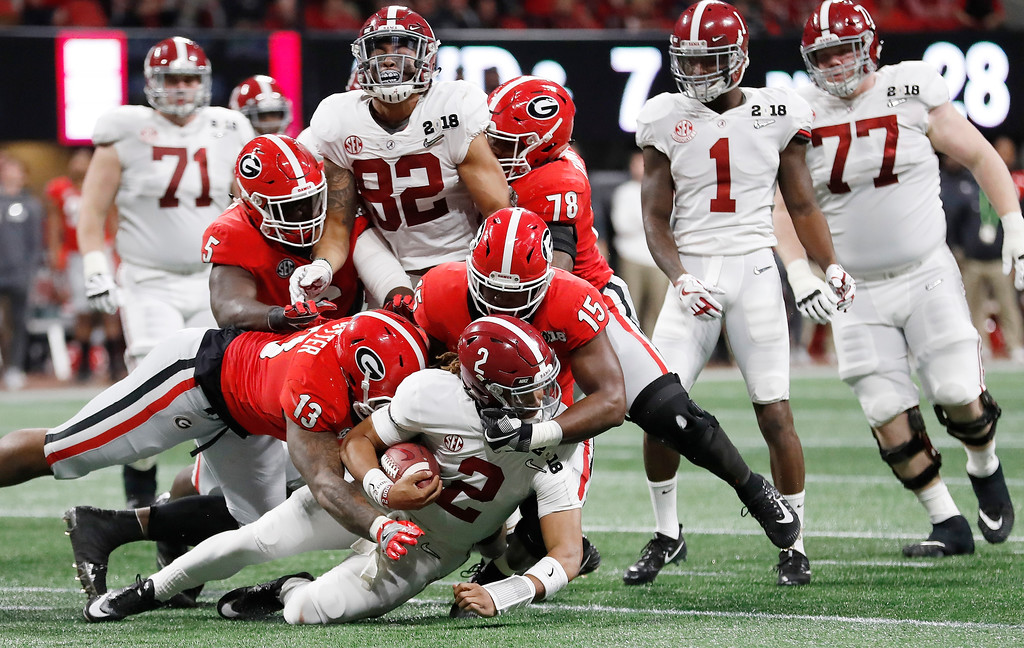 . Alabama quarterback Jalen Hurts is stopped during the first half of the NCAA college football playoff championship game against Georgia Monday, Jan. 8, 2018, in Atlanta. (AP Photo/David Goldman)