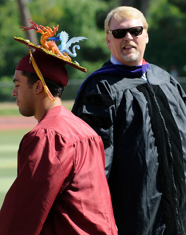 . Frank Ferry, Principal, comments on the dragons worn by Andrew Hemphill. The Commencement Exercises for the Bishop Alemany High School Class of 2013 was held at College of the Canyons in Santa Clarita, CA 6/1/2013(John McCoy/LA Daily News)