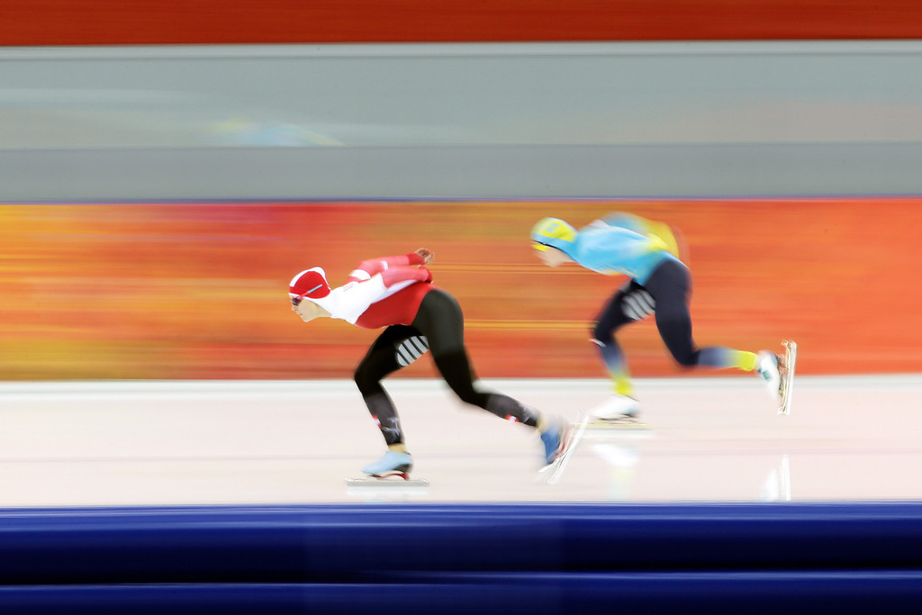 . Vanessa Bittner (L) of Austria and Yekaterina Aydova (R) of Kazakhstan compete during the Women\'s 1500m Speed Skating event on day 9 of the Sochi 2014 Winter Olympics at Adler Arena Skating Center on February 16, 2014 in Sochi, Russia.  (Photo by Adam Pretty/Getty Images)