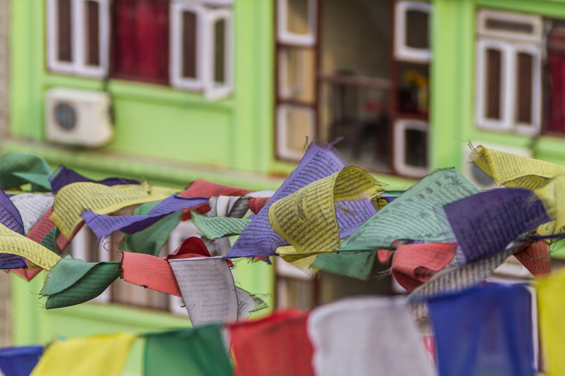 Multi-coloured prayer flags hanging on lines - Nepal