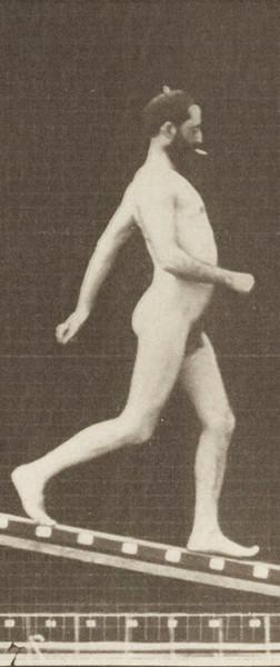 Nude man descending an incline