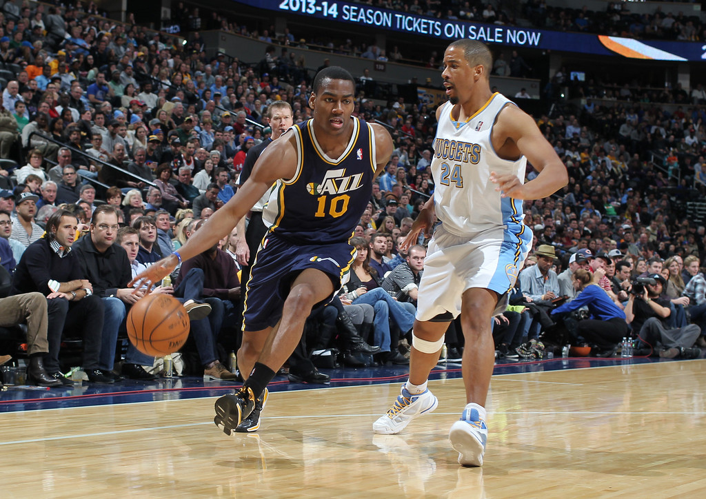 . Utah Jazz guard Alec Burks, left, works ball inside for shot past Denver Nuggets guard Andre Miller in the fourth quarter of Utah\'s 103-93 victory in an NBA basketball game in Denver on Friday, Dec. 13, 2013. (AP Photo/David Zalubowski)