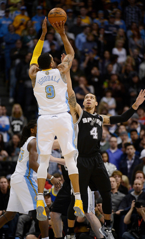 . The Denver Nuggets Andre Iguodala (9) takes a shot over San Antonio Spurs  Danny Green (4) during the first quarter April 10, 2013 at Pepsi Center. (Photo By John Leyba/The Denver Post)