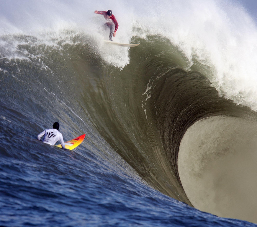 . Evan Slater catches a wave during the first heat of the Mavericks Surf Contest in Princeton-by-the-Sea, Calif., on Saturday, Feb. 13, 2010.  Twenty-four of the world\'s best big wave surfers are competing. (Jane Tyska/Staff)