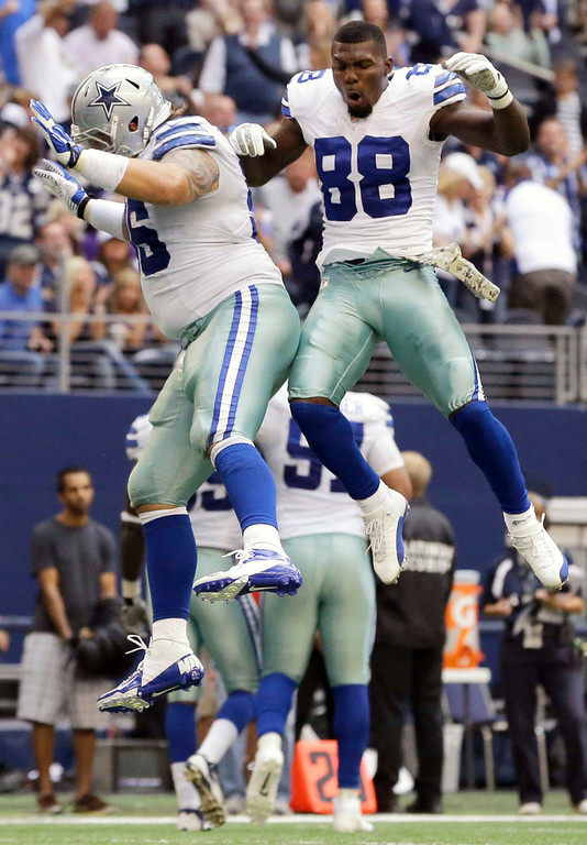 . Dallas Cowboys\' Nick Hayden (96) and Dez Bryant (88) celebrate a touchdown by Hayden in the second half of an NFL football game, Sunday, Nov. 3, 2013, in Arlington, Texas. Hayden recovered a fumble by Minnesota Vikings\' Christian Ponder who lost the ball in the end zone. (AP Photo/Nam Y. Huh)