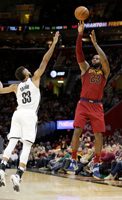 . Cleveland Cavaliers\' LeBron James (23) shoots over Brooklyn Nets\' Allen Crabbe (33) in the second half of an NBA basketball game, Wednesday, Nov. 22, 2017, in Cleveland. (AP Photo/Tony Dejak)