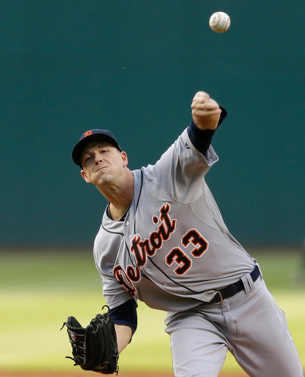 . Detroit Tigers starting pitcher Drew Smyly delivers in the first inning of a baseball game against the Cleveland Indians, Monday, May 19, 2014, in Cleveland. (AP Photo/Tony Dejak)