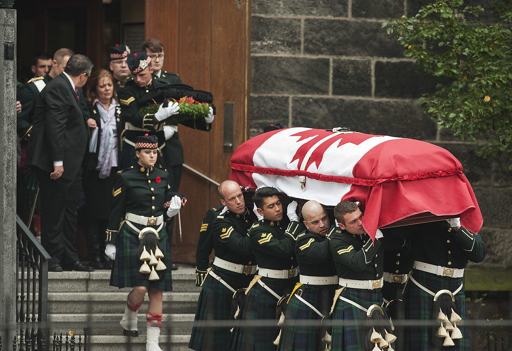 . Kathy Cirillo (L), walks out from the Christ\'s Church Cathedral as the casket of her son Cpl. Nathan Cirillo is carried out during his funeral on October 28, 2014 in Hamilton, Ontario, Canada.  (Photo by Aaron Vincent Elkaim/Getty Images)