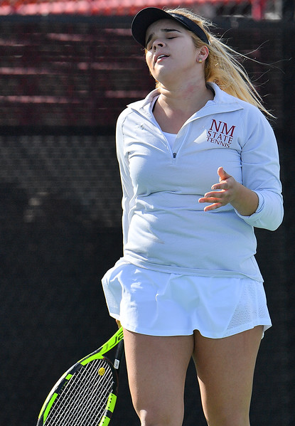 LAS VEGAS, NV - JANUARY 20:  Vanessa Valdez of the New Mexico State Aggies reacts after losing a point during her match against Caitlin Herb of the Weber State Wildcats at the Frank and Vicki Fertitta Tennis Complex in Las Vegas, Nevada. Herb won the match 6-4, 7-6 (10-5)