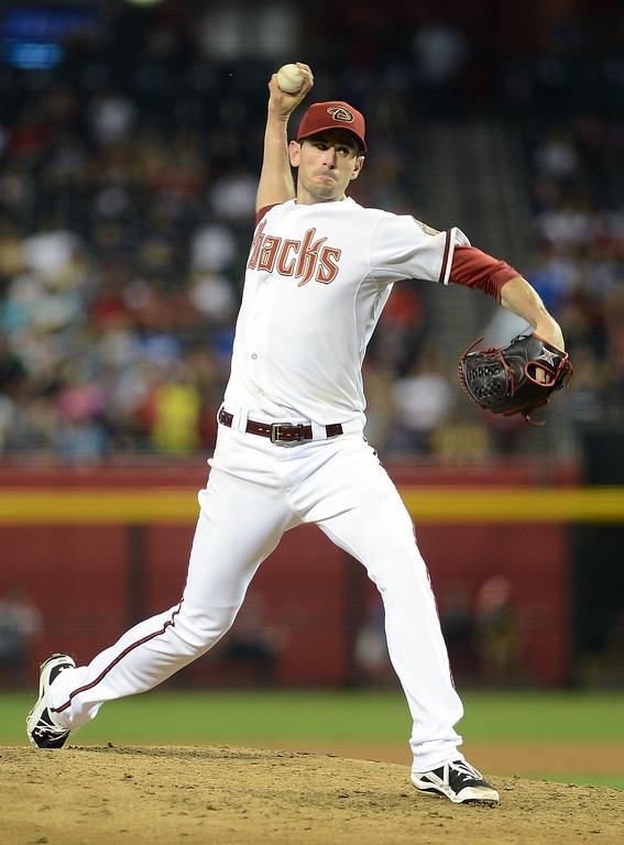 . PHOENIX, AZ - APRIL 26:  Brandon McCarthy #32 of the Arizona Diamondbacks pitches against the Colorado Rockies in the sixth inning at Chase Field on April 26, 2013 in Phoenix, Arizona.