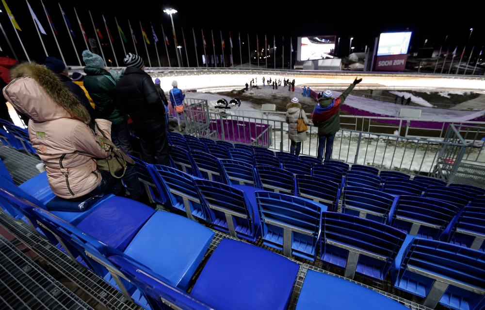 . Supporters attend the second heat of the men\'s singles luge competition at the 2014 Winter Olympics, Saturday, Feb. 8, 2014, in Krasnaya Polyana, Russia. (AP Photo/Michael Sohn)