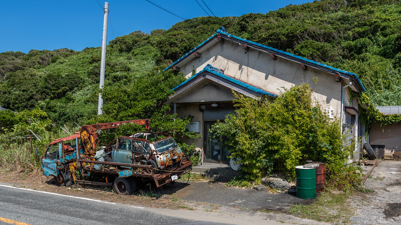 Beautiful Trash! Both the tow truck and the loaded Mini Mayfair must have been resting here fore a long time. The unforgiving humid and salty air close to cape Sunosaki has reduced them both into hardly recognizable sculptures of rust. No clear winner between British and Japanese steel! HDR developed from one shot with the M3 and the F17-40L lens.