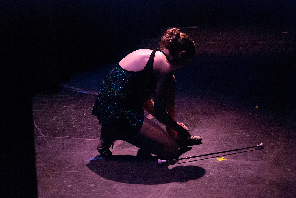 . Kayla Rice/Reformer 2013 Winter Carnival Queen Alison Cornellier ties her shoe  backstage before performing her baton routine during the 2014 Brattleboro Winter Carnival Queen\'s Pageant on Friday evening.
