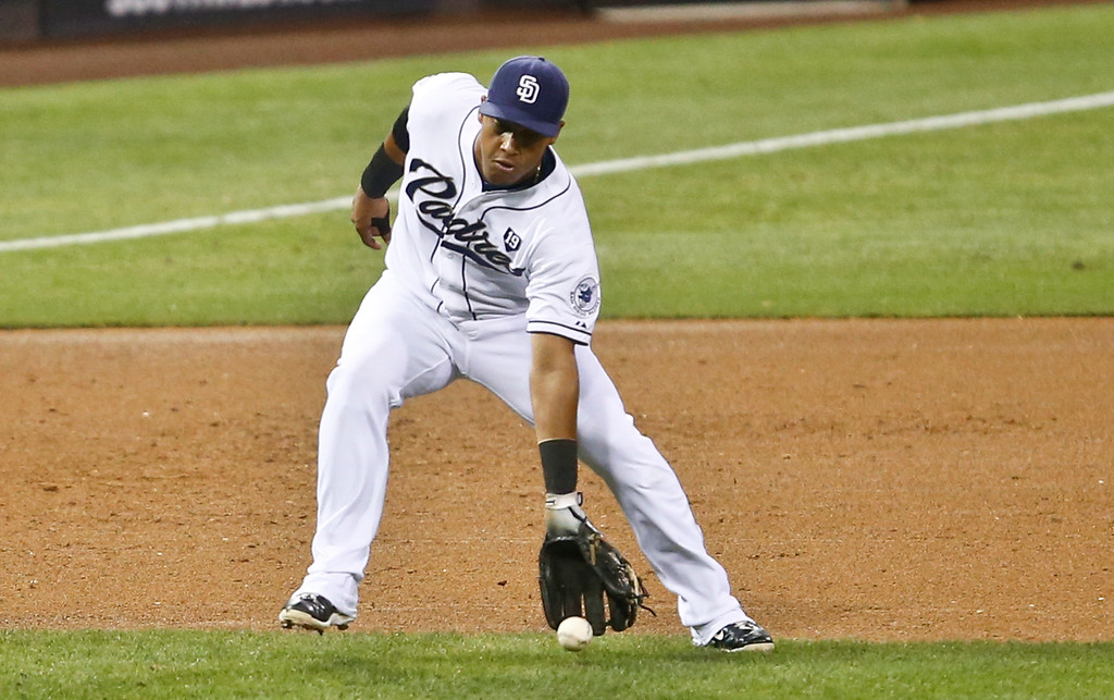 . San Diego Padres third baseman Yangervis Solarte fields an infield bloop on one hop hit by Colorado Rockies\' Rafael Ynoa with two runners on base during the second inning of a baseball game Monday, Sept. 22, 2014, in San Diego. Umpire Jerry Meals called the infield fly rule preventing the Padres form getting a double play. (AP Photo/Lenny Ignelzi)