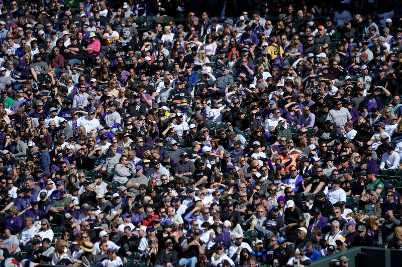 . DENVER, CO. - APRIL 04: Fans watch a foul ball during the Colorado Rockies home opener against the Arizona Diamondbacks at Coors Field in Denver, CO April 04, 2014. (Photo By Craig F. Walker / The Denver Post)