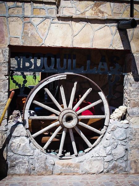 Wagon wheel decor in front of  Jose Falcon's.