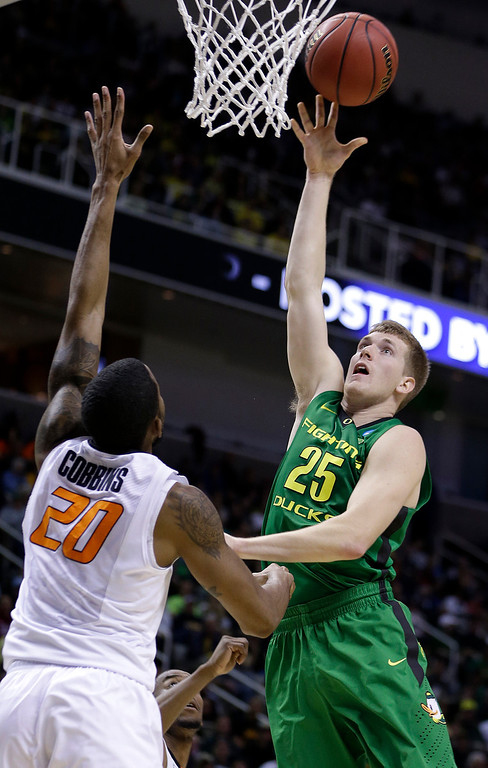 . Oregon forward E.J. Singler (25) shoots over Oklahoma State forward Michael Cobbins (20) during the first half of a second-round game in the NCAA college basketball tournament in San Jose, Calif., Thursday, March 21, 2013. (AP Photo/Ben Margot)