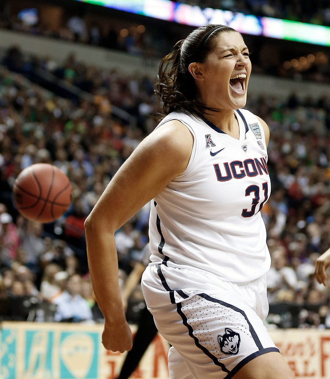 . Connecticut center Stefanie Dolson (31) celebrates her basket against Notre Dame during the second half of the championship game in the Final Four of the NCAA women\'s college basketball tournament, Tuesday, April 8, 2014, in Nashville, Tenn. (AP Photo/John Bazemore)