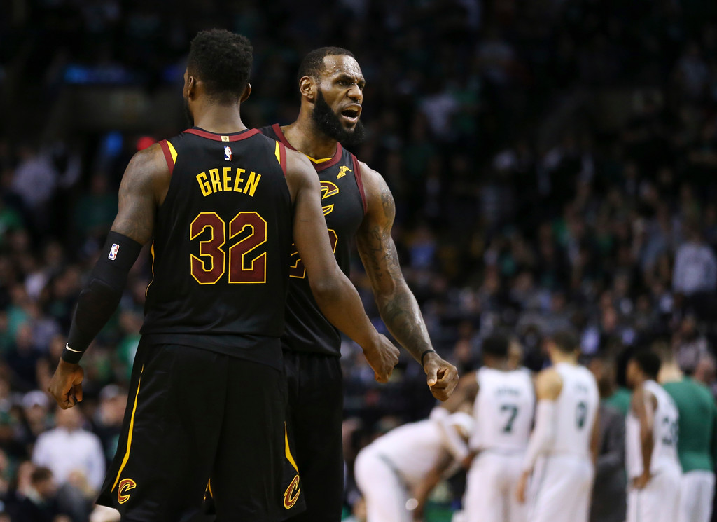 . Cleveland Cavaliers forwards LeBron James, right, and Jeff Green celebrate a play during the second half in Game 7 of the NBA basketball Eastern Conference finals against the Boston Celtics, Sunday, May 27, 2018, in Boston. (AP Photo/Elise Amendola)