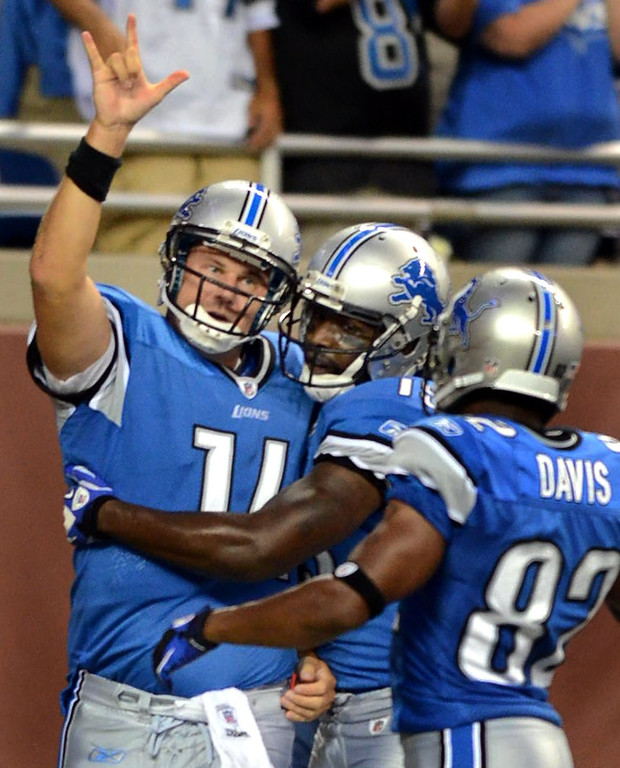 . Detroit Lions backup QB Shaun Hill #14 celebrates with teammates WR Derrick Williams and WR Rashied Davis after his touchdown run during their preseason game against the Cincinnati Bengals at Ford Field, Friday August 12, 2011. (Oakland Press Photo By: Vaughn Gurganian)