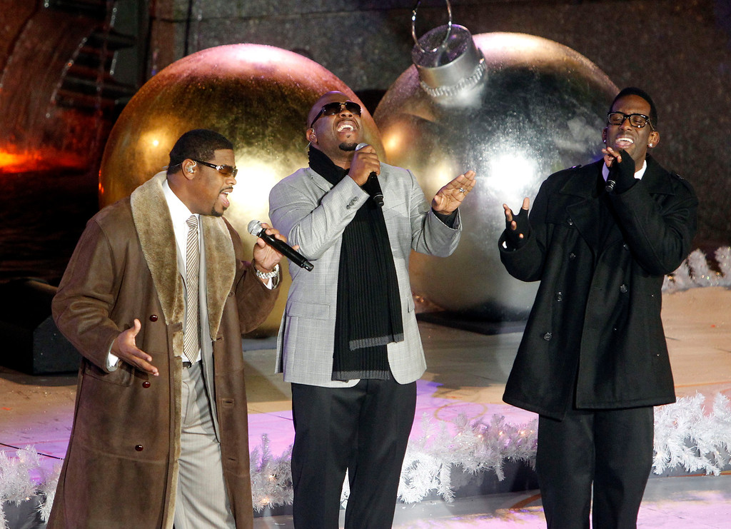 . Members of the group Boyz II Men, from left, Nathan Morris, Wanya Morris and Shawn Stockman perform during the 78th annual Rockefeller Center Christmas tree lighting ceremony Tuesday, Nov. 30, 2010, in New York. (AP Photo/Jason DeCrow)