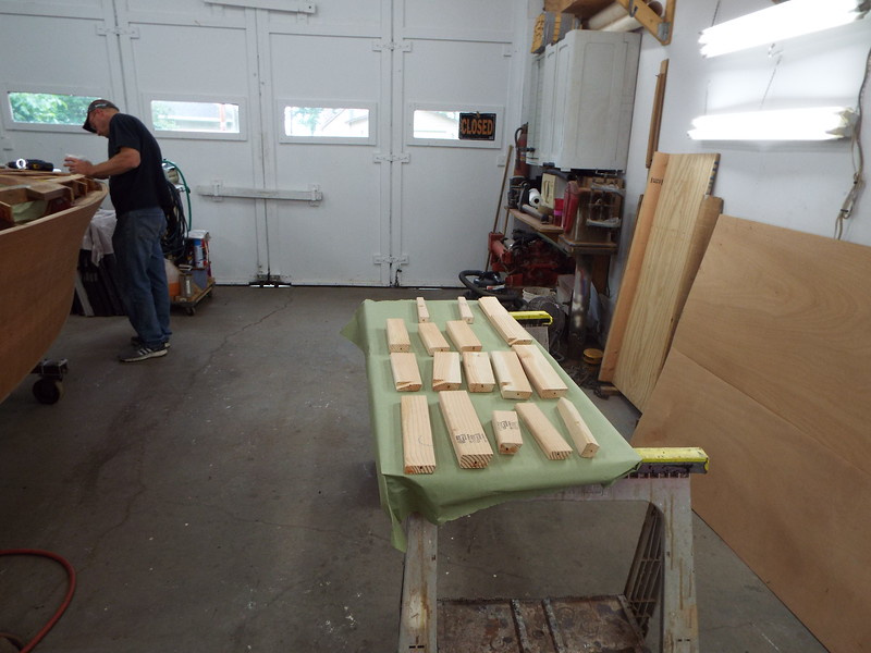Applying epoxy to the hull for the new blocks. Starboard deck blocks removed ready for epoxy.