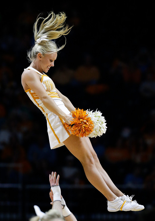 . Tennessee cheerleaders perform during the first half of a first-round game in the NCAA women\'s college basketball tournament against Northwestern State Saturday, March 22, 2014, in Knoxville, Tenn. (AP Photo/Mark Humphrey)