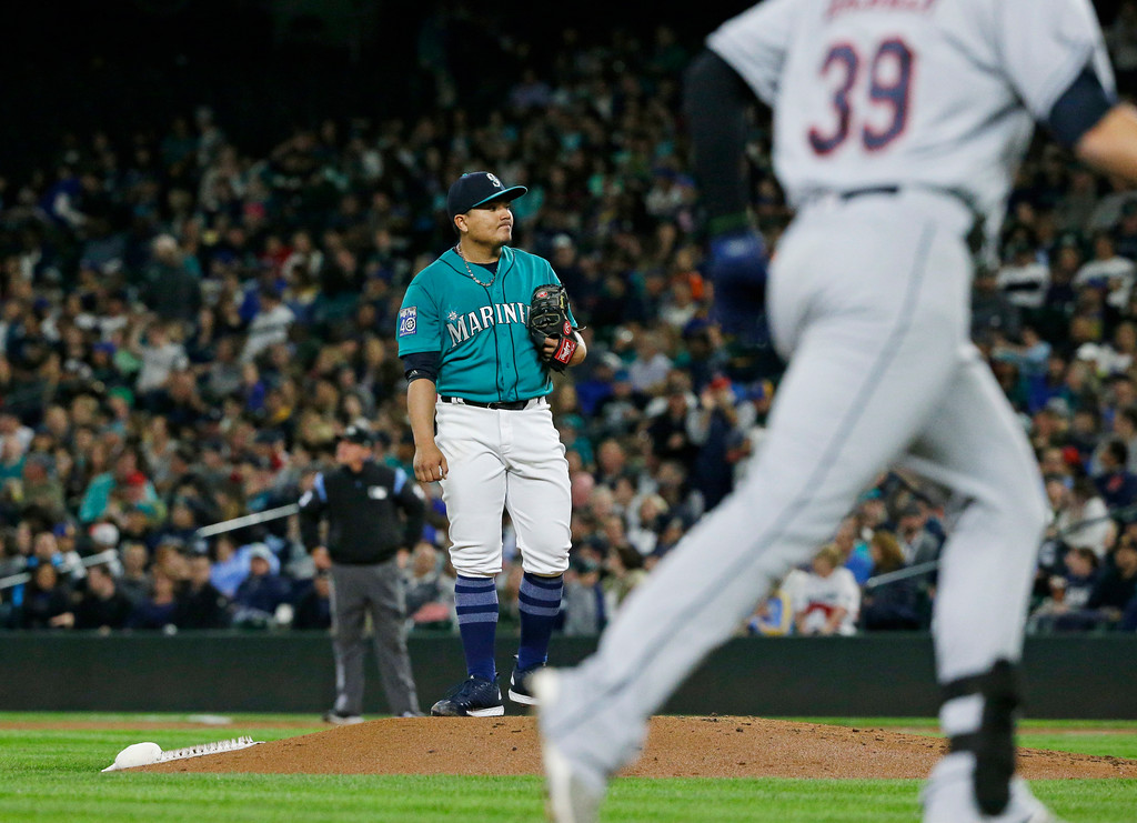 . Seattle Mariners starting pitcher Erasmo Ramirez stands on the mound as Cleveland Indians\' Giovanny Urshela rounds the bases after hitting a solo home run during the third inning of a baseball game, Friday, Sept. 22, 2017, in Seattle. (AP Photo/Ted S. Warren)