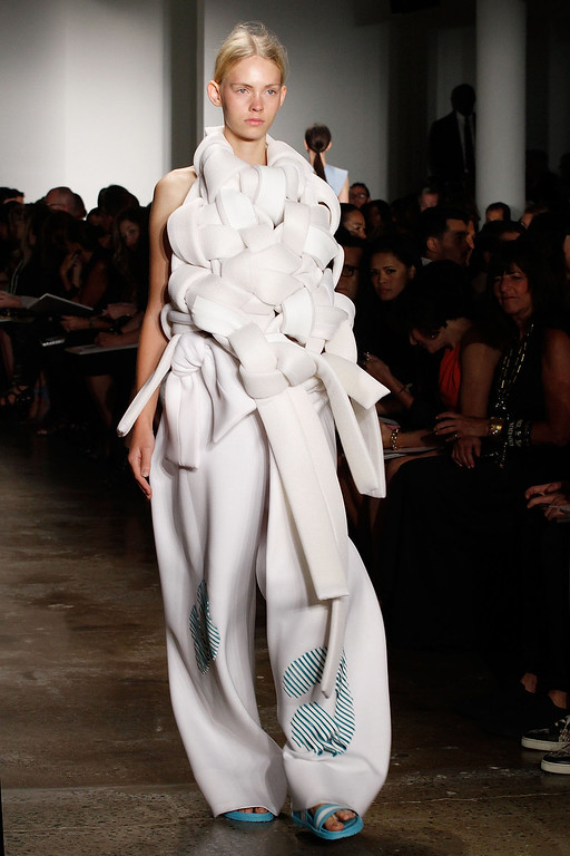 . A model walks the runway wearing Jiapei Li\'s collection at Parsons MFA runway show during MADE Fashion Week Spring 2015 at Milk Studios on September 6, 2014 in New York City.  (Photo by Mireya Acierto/Getty Images)