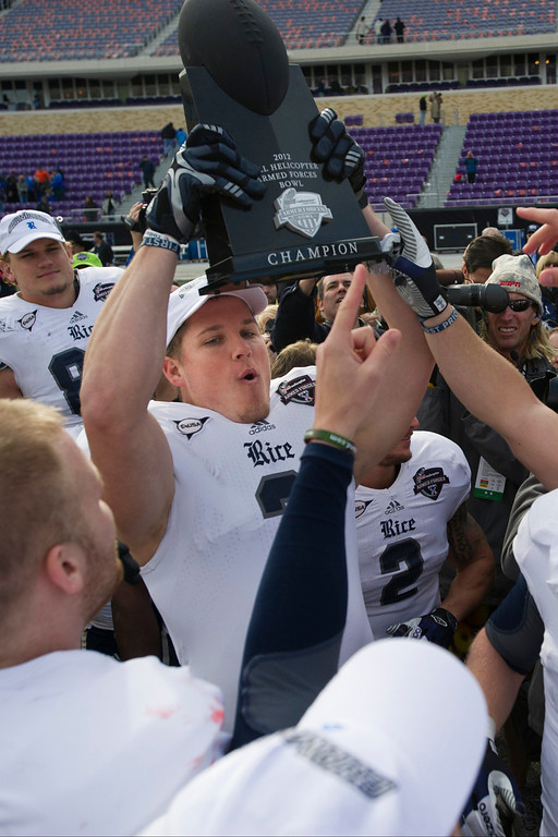 . Taylor Cook #3 of the Rice Owls hoists the trophy after defeating the Air Force Falcons in the Bell Helicopter Armed Forces Bowl on December 29, 2012 at Amon G. Carter Stadium in Fort Worth, Texas.  (Photo by Cooper Neill/Getty Images)