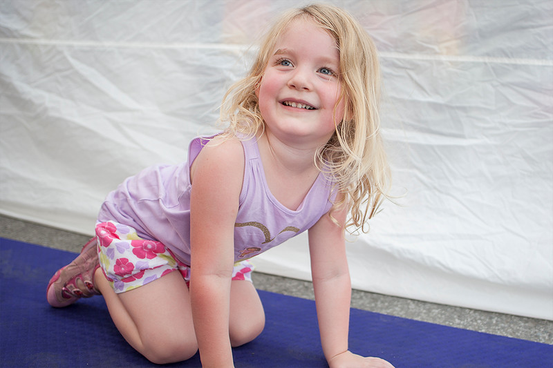 Sisters; personal trainer and kids yoga instructor, Erin Truitt and photojournalist, race, and sport photographer Megan Sebeck teamed up at Bentonville's First Friday: Back to School on the Square to educate, entertain, and photograph guests who stopped at their booth.