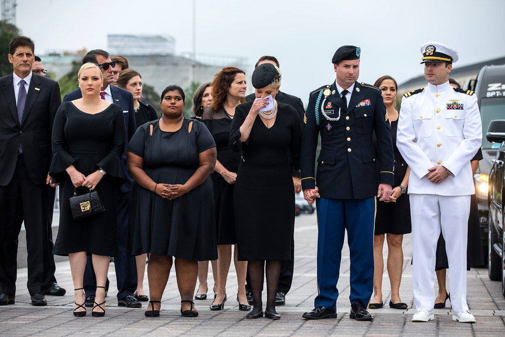 . The family of Sen. John McCain, R-Ariz., including from left, Andrew McCain, Doug McCain, Meghan McCain,  Bridget McCain, Cindy McCain, Jimmy McCain and Jack McCain, watch as the casket is carried down the steps of the U.S. Capitol in Washington, Saturday, Sept. 1, 2018, in Washington, for a departure to the Washington National Cathedral for a memorial service.   (Jim Lo Scalzo/Pool photo via AP)