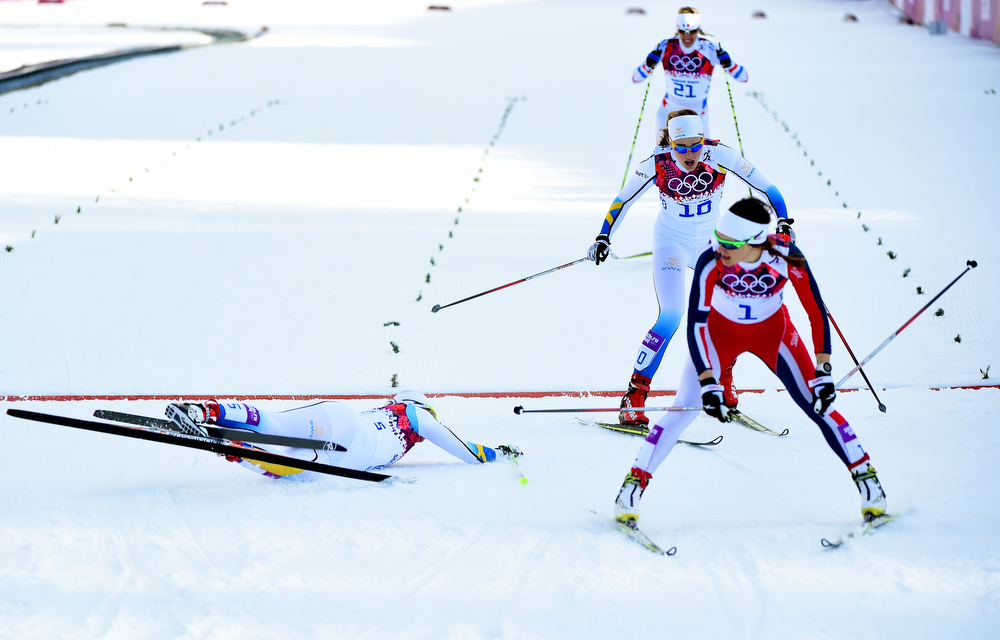 . (L-R) Ida Ingemarsdotter of Sweden, Stina Nilsson of Sweden and Maiken Caspersen Falla of Norway cross the finish line in the Finals of the Ladies\' Sprint Free during day four of the Sochi 2014 Winter Olympics at Laura Cross-country Ski & Biathlon Center on February 11, 2014 in Sochi, Russia.  (Photo by Harry How/Getty Images)