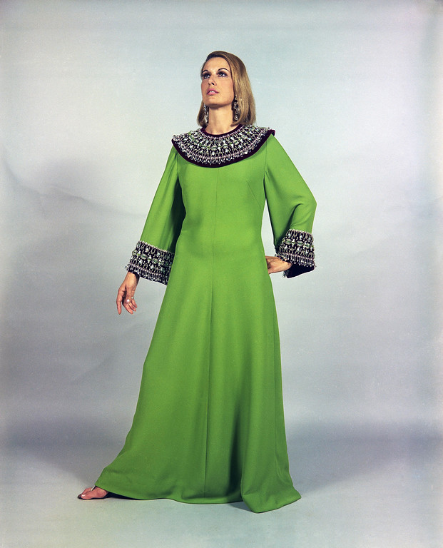 . A long evening dress, named �Esmeralda�, of heavy green craped silk, richly embroidered with green crystals around the neckline and at the cuffs, a creation by the Eleanora Garnett fashion house of Rome, July 13, 1968, to be presented at its show of fall and winter fashions in Rome on July 14. (AP Photo/Mario Torrisi)