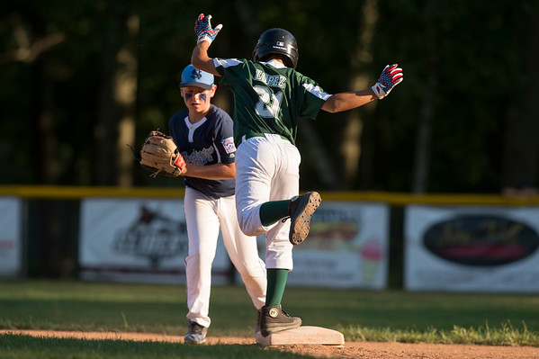 07/08/19 Wesley Bunnell | Staff Forrestville vs Southington North Little League baseball at Recreation Park in Southington on Monday July 8, 2019. Aiden Lopez (21) with a balancing act after reaching second base on a double.