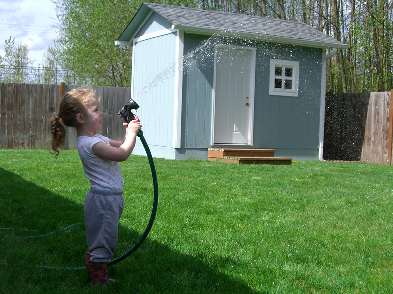 Kimber playing with the water hose on a sunny Easter Sunday morning.
