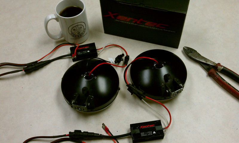 """I drilled a 3/4"""" hole in the back of each light case to allow the base of the H3 HID bulb and its wires to protrude."""