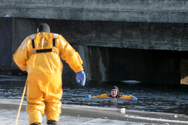 Leominster Fire Department held an ice rescue training on Monday, Dec. 23, 2019 during the warm 50 degree day on Rockwell Pond behind the Senior Center. Waiting for his fellow firefighters to come rescue him is Firefighter Adam Condio. SENTINEL & ENTERPRISE/JOHN LOVE