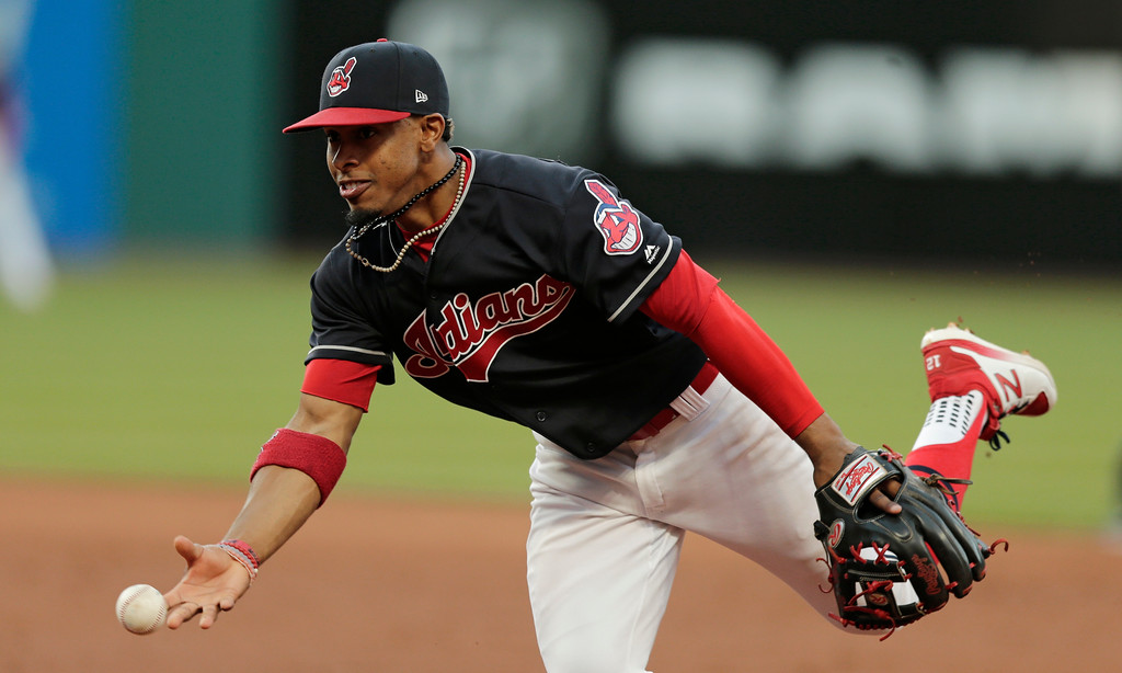 . Cleveland Indians\' Francisco Lindor tosses the ball to first base to get out Tampa Bay Rays\' Colby Rasmus in the fifth inning of a baseball game, Monday, May 15, 2017, in Cleveland. (AP Photo/Tony Dejak)